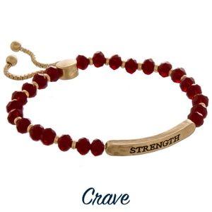"""Strength"" bracelet metal face with facet beads"